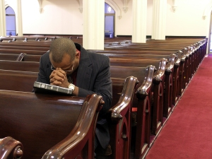 Believer Praying in Church